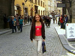 Teen Claudia walks along the streets of Prague