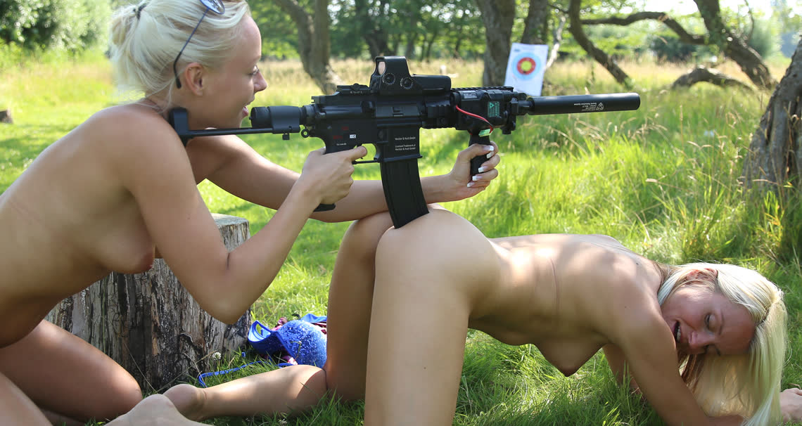 topless teens with guns