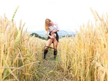 Schoolgirl pleasuring herself in a wheat field