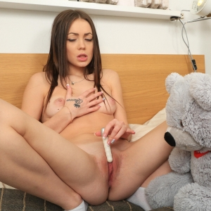 Sexy Lou masturbating her freshly shaved pussy