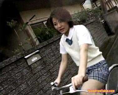 Tokyo schoolgirl on a bicycle